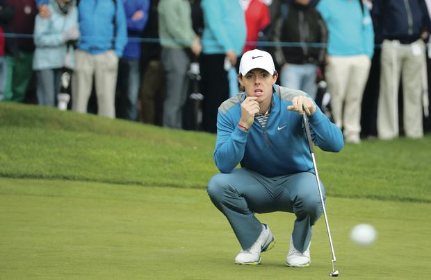 On course: Rory McIlroy lines up a putt during day two of the BMW PGA Championship at Wentworth