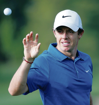 Feeling good: Rory McIlroy has a spring in his step during practice yesterday