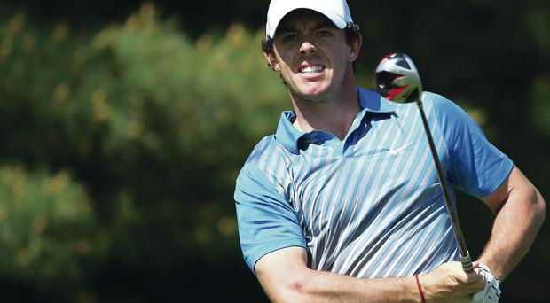Close eye: Rory McIlroy watches his tee shot on the 17th hole yesterday