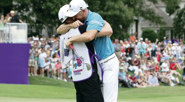 Top class: An overjoyed Ben Crane embraces caddy Joel Stock last night after claiming victory at the St Jude Classic