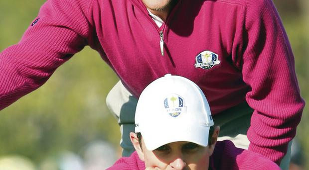 Eyeing up: Ian Poulter (top) expects no favours from Justin Rose (bottom) despite the pair's close friendship and partnership, including at the 2012 Ryder Cup at Medinah (pictured)