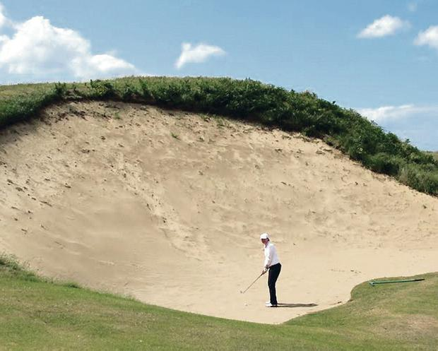 Daunting task: Big Nellie is a feared bunker on the Royal Portrush course but it may disappear when changes are required