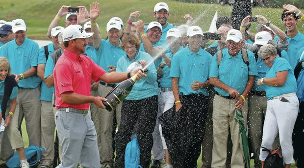 Lovely bubbly: Graeme McDowell breaks out the victory champagne