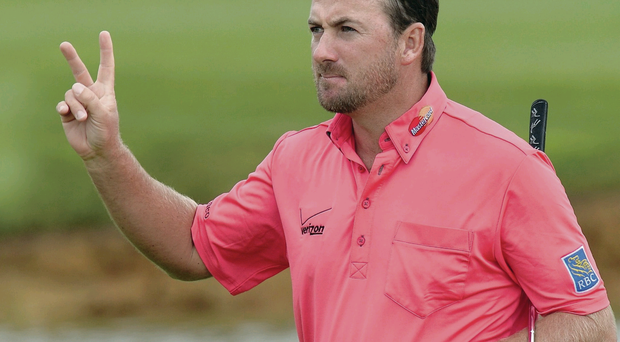Just champion: Graeme McDowell acknowledges the crowd after retaining the French Open crown in Paris at the weekend