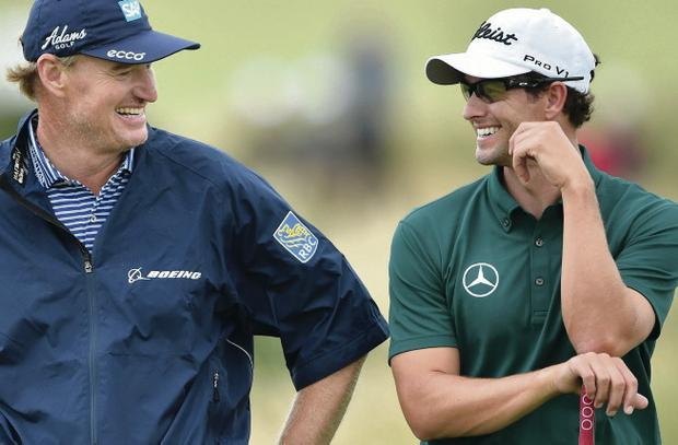 Smiles better: Ernie Els (left) jokes with Adam Scott