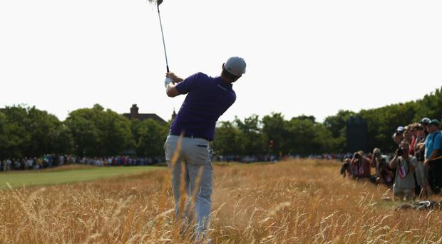 Justin Rose of England plays from the deep rough on the fourth hole during the second round of The 143rd Open Championship at Royal Liverpool yesterday
