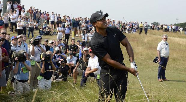 Tiger Woods dropped three shots on the opening two holes