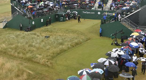 Defending champion Phil Mickelson was watched by an almost full grandstand behind the first tee