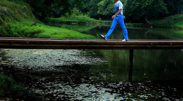 Walking on water: In-form Rory McIlroy during his final practice round with Darren Clarke at Valhalla