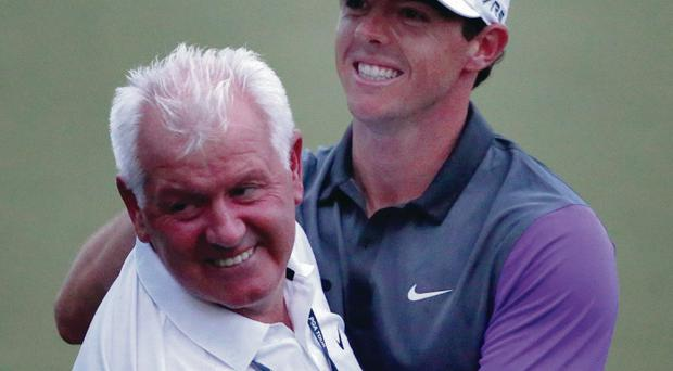 Happy families: Rory McIlroy is congratulated by dad Gerry after completing a comeback on the back nine to clinch the US PGA title
