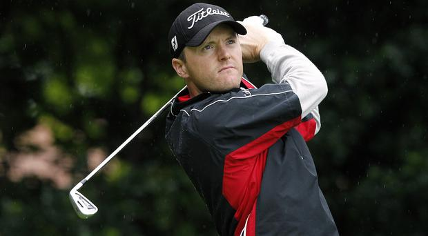 On course: Michael Hoey in action before the rain came