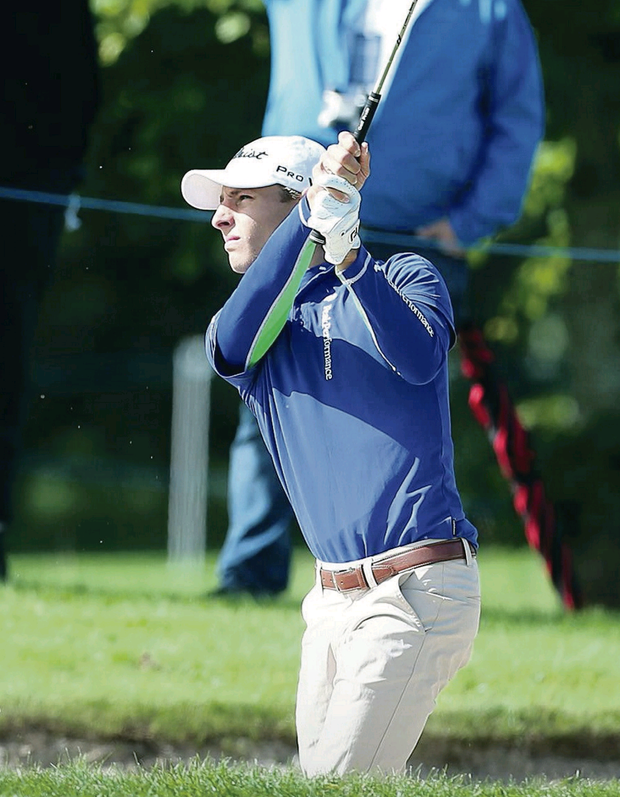 On target: Leader Joakim Lagergren on his way to a course record 62 at Galgorm Castle