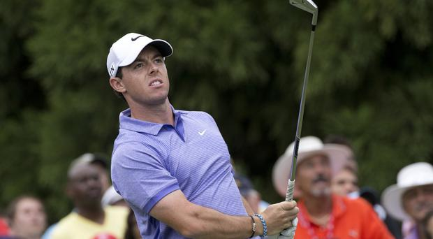 Rory McIlroy, pictured, struggled to a closing 71 as playing partner Billy Horschel won the Tour Championship and the FedEx Cup title (AP)