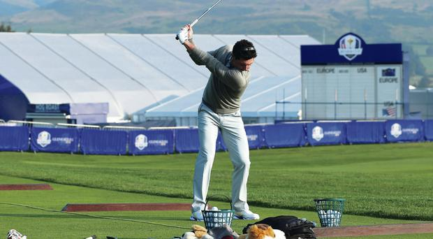 Back in the swing: Rory McIlroy gets his practice under way at Gleneagles ahead of the Ryder Cup on Friday