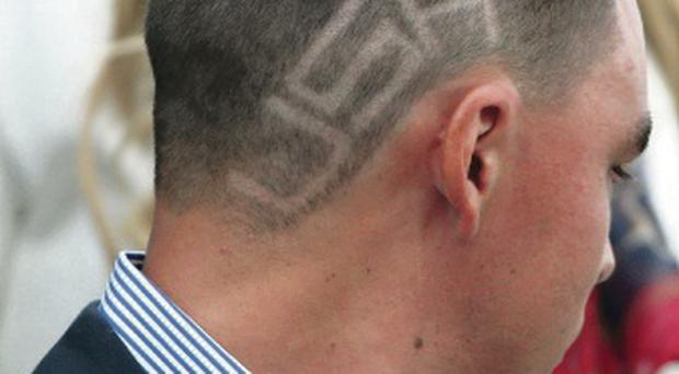 A close shave: Rickie Fowler shows off his patriotic haircut
