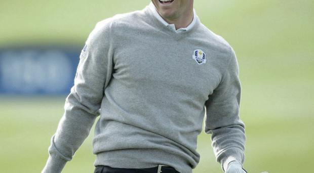 Winning smile: Rory McIlroy was in good spirits yesterday ahead of this weekend's Ryder Cup action
