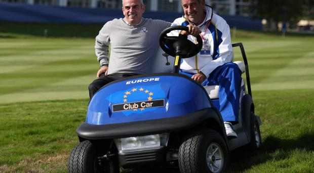 Wheels in motion: European Ryder Cup captain Paul McGinley and Sam Torrance get in gear yesterday