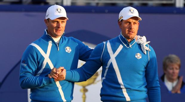 Henrik Stenson, right, and Justin Rose got Europe's defence of the Ryder Cup under way at Gleneagles