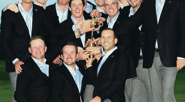 In safe hands: The Europe team and captain Paul McGinley with the Ryder Cup after their Gleneagles success