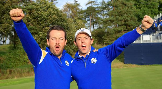 Star performers: Rory McIlroy and Graeme McDowell led by example for Team Europe