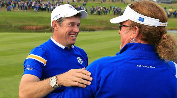 Lee Westwood, left, has backed Darren Clarke to be Ryder Cup captain