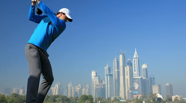 In the swing: Rory McIlroy takes part in the Pro-Am ahead of the 2015 Dubai Desrt Classic on the Majlis Course at the Emirates Golf Club