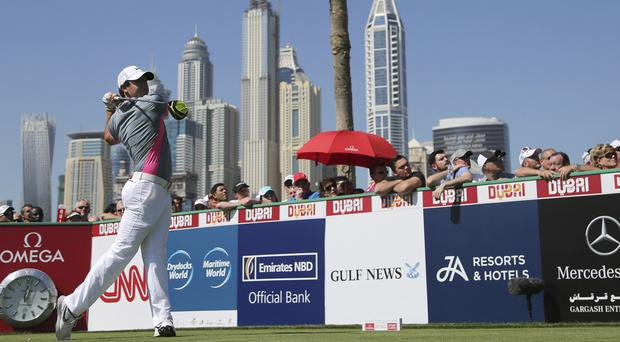 Rory McIlroy tops the leaderboard in Dubai (AP)