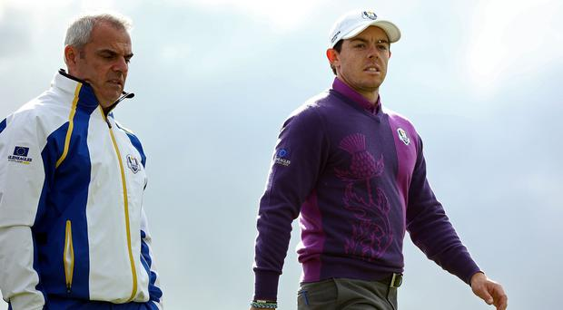 Paul McGinley, left, wants the spotlight off Rory McIlroy at Augusta