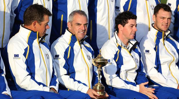 Paul McGinley (centre left), believes Rory McIlroy (centre right) cannot be compared to Tiger Woods just yet