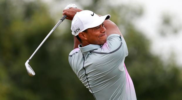 Tiger Woods, pictured, believes Rory McIlroy will win several Masters titles