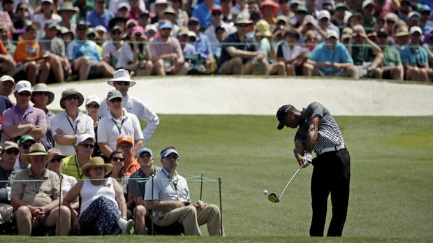 Tiger Woods made the ideal start with a hat-trick of birdies from the second to move to five under par (AP)