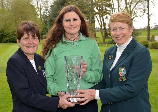 Rising star: Olivia Mehaffey receives the Irish Girls Open trophy from Roganstown Captain Aine Derham (left) and ILGU President Valerie Hassett
