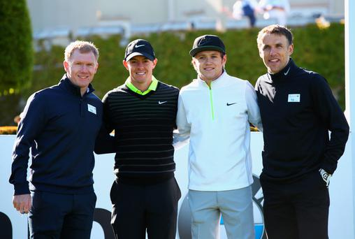 Men united: Rory McIlroy poses with Niall Horan of One Direction and former Manchester United stars Paul Scholes (left) and Phil Neville (right)