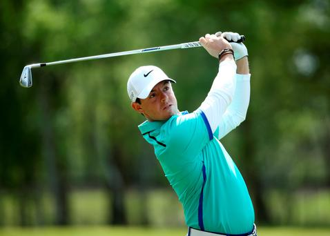 On target: Rory McIlroy hits his second shot on the ninth hole on his way to a one under par 71 in the first round of the BMW PGA Championship at Wentworth