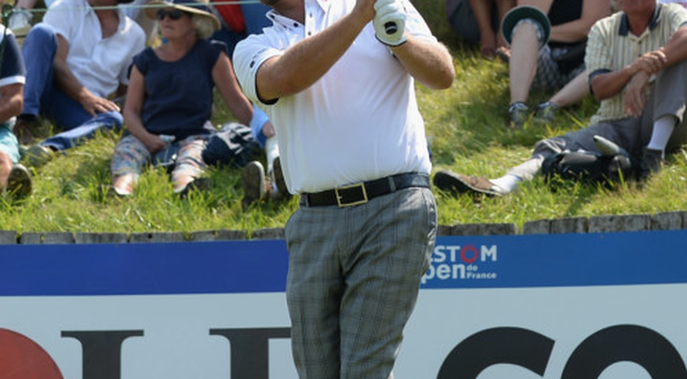 Down and out: Graeme McDowell's hopes of winning a third successive French Open title are over after he failed to make the cut