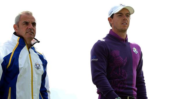 Paul McGinley, pictured left, fears Rory McIlroy, right, will miss the Open Championship