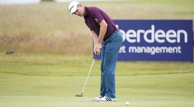 Justin Rose has a share of the lead at the Scottish Open