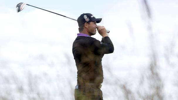 Ireland's Padraig Harrington went back to bed after rain delayed the Open
