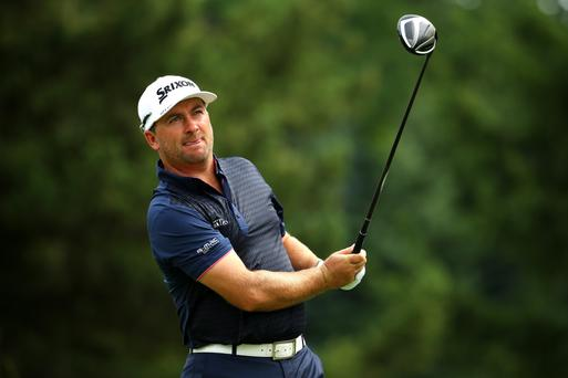 On form: Graeme McDowell off the 13th tee in last night's first round of the Bridgestone Invitational in Akron, Ohio