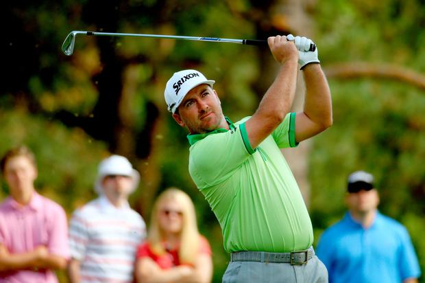 In the swing: Graeme McDowell is at the right end of the WGC Bridgestone Invitational scoreboard despite a second-round 71
