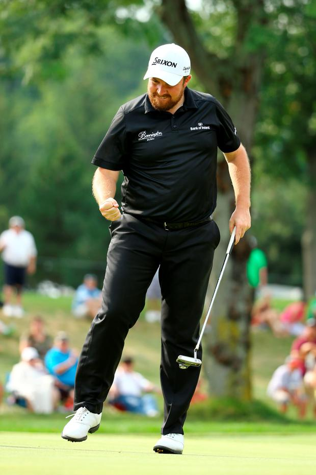 Get in: Shane Lowry sinks the winning putt on the 18th green for victory at the WGC Bridgestone Invitational at Akron