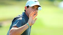 Rory McIlroy of Northern Ireland reaches for a golf ball on the practice ground during a practice round prior to the 2015 PGA Championship at Whistling Straits on August 12, 2015 in Sheboygan, Wisconsin. (Photo by Richard Heathcote/Getty Images)
