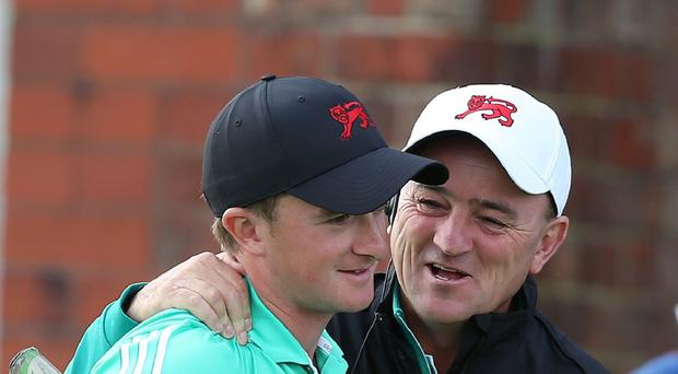 Great Britain and Ireland captain Nigel Edwards celebrates with Paul Dunne