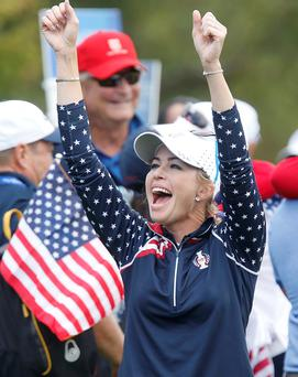 Job done: Paula Creamer celebrates after making the final point, sealing the American win