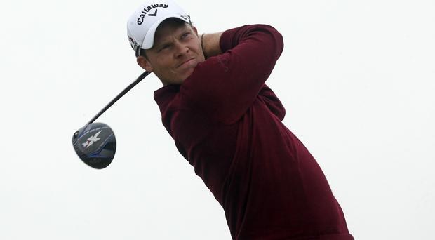 Danny Willett, pictured, is determined to catch Rory McIlroy in the Race to Dubai