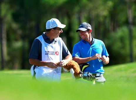 Turkish delight: Rory McIlroy enjoying a practice round with caddie JP Fitzgerald ahead of the Turkish Airlines Open