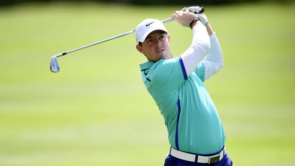 Rory McIlroy, pictured, remained in pursuit of leader Jaco van Zyl in Turkey