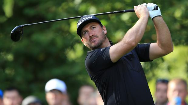 Graeme McDowell, pictured, is tied with Russell Knox in the weather-affected OHL Classic