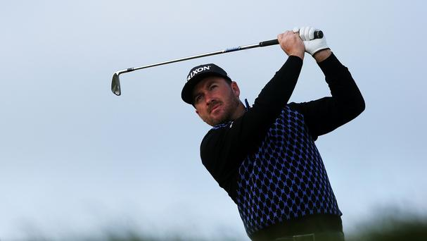 Near miss: Graeme McDowell just fell short of back-to-back wins