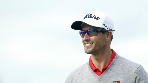 Adam Scott claimed his first win since reverting from an anchored putter